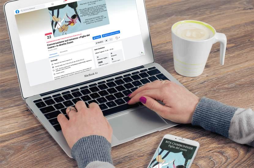 Diretta Zoom: lo schermo di un computer e due mani su una tastiera